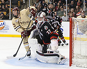 Patrick Brown (BC - 23), Chris Rawlings (NU - 37), Adam Reid (NU - 8) - The Boston College Eagles defeated the Northeastern University Huskies 6-3 for their fourth consecutive Beanpot championship on Monday, February 11, 2013, at TD Garden in Boston, Massachusetts.