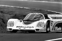 LAKEVILLE, CT - MAY 27: The BF Goodrich Porsche 962 106 driven by Jim Busby and Rick Knoop lifts a wheel en route to a sixth place finish during the Coca Cola 500 IMSA GTP/Lights race at Lime Rock Park near Lakeville, Connecticut, on May 27, 1985.