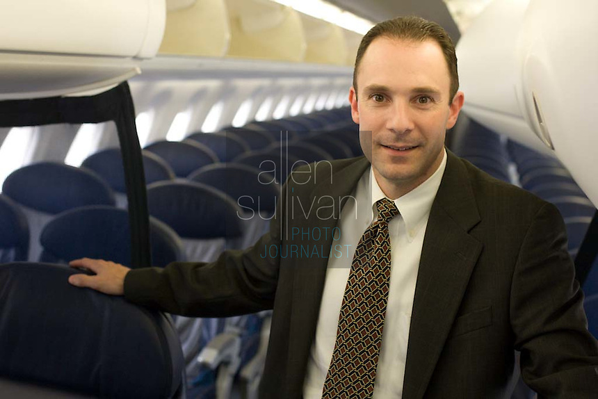 Wayne Aaron (cq), vice president of Delta Connection, in one of the airline's regional jets and in a terminal on Wednesday, May 30, 2007. Delta taking over ASA's ground operations in Atlanta.