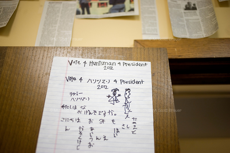 "A sign that says ""Vote 4 Huntsman 4 President 2012"" in English and Japanese hangs on a door at the Jon Huntsman New Hampshire campaign headquarters in Manchester, New Hampshire, on Jan. 7, 2012.  Huntsman is seeking the 2012 Republican presidential nomination."