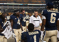 Pitt coach Todd Graham congratulating Ray Graham. The Pittsburgh Panthers beat the Buffalo Bulls 35-16 at Heinz field in Pittsburgh, Pennsylvania on September 3, 2011