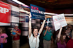 A supporter of Republican presidential hopeful Rick Santorum files into the Hilton Coliseum to hear the candidate speak at the Iowa Republican Straw Poll on Saturday, August 13, 2011 in Ames, IA.