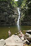 Hawaii: Molokai, Halawa Valley, couple at waterfalls, after hike in past taro fields, ancient walls, to waterfalls, guided by Lawrence Aki.  Model released..Photo himolo238-72432..Photo copyright Lee Foster, www.fostertravel.com, lee@fostertravel.com, 510-549-2202