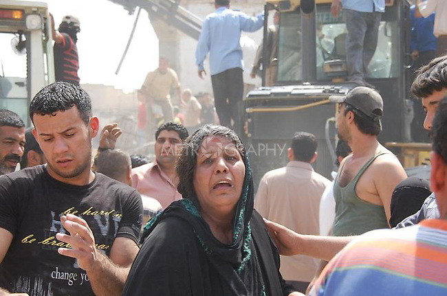 BAGHDAD, IRAQ: A woman in the aftermath of a bomb explosion in the Alawi neighborhood, a Shia area in Baghdad...Bombs destroyed seven buildings in three areas of the Iraqi capital Baghdad, killing at least 28 people and wounding 75.