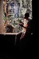Buddhist Nun at the Bayon Temple, Siem Reap Cambodia