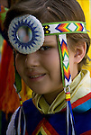 Portrait of young Native American boy wearing Pow Wow Regalia. Examples of ethnic pride, heritage, celebration, and traditional folk art crafts
