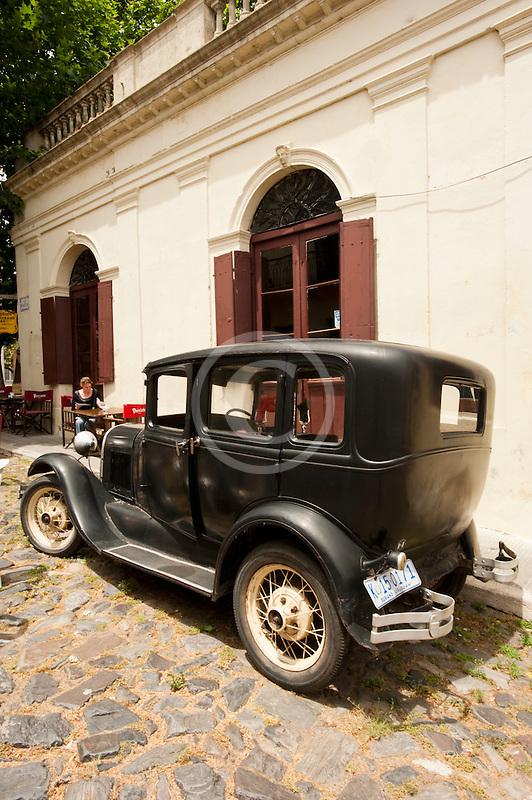 Uruguay, Colonia del Sacramento, Abandoned antique automobile on cobbled street