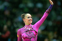 """Marina Shpekht of Russia waves to fans during event finals at 2007 World Cup Kiev, """"Deriugina Cup"""" in Kiev, Ukraine on March 18, 2007."""