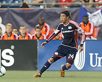 New England Revolution midfielder Lee Nguyen (24) passes the ball.  In a Major League Soccer (MLS) match, the New England Revolution (blue) tied D.C. United (white), 0-0, at Gillette Stadium on June 8, 2013.