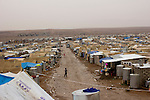DOMIZ, IRAQ: The Domiz refugee camp in the Kurdish region of northern Iraq...The semi-autonomous region of Iraqi Kurdistan has accepted around 60,000 refugees from war-torn Syria. Around 20,000 refugees live in the Domiz camp which sits 60 km from the Iraq-Syria border...Photo by Younes Mohammad/Metrography