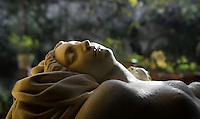 Detail of reclining nude sculpture in the garden, Casa de Pilatos (Pilate's House), Seville, Spain, pictured on December 30, 2006, in the afternoon. Pilate's House, late 15th century, was built by the Enriquez and Ribera families. During the 16th century these families, who had a strong relationship with Italy,  introduced the Renaissance style to Seville. In the palace is the sculpture collection of the Duke of Alcala  who brought back many Classical pieces from Italy and adapted the palace and gardens to exhibiting them in Renaissance style. The buildings were further modified according to Romantic taste in the 19th century and now present a combination of Mudejar-Gothic, Renaissance and Romantic styles. Today the Casa de Pilatos belongs to the Fundacion Casa Ducal de Medicaneli and is the residence of the Dukes of Medicaneli. Picture by Manuel Cohen.