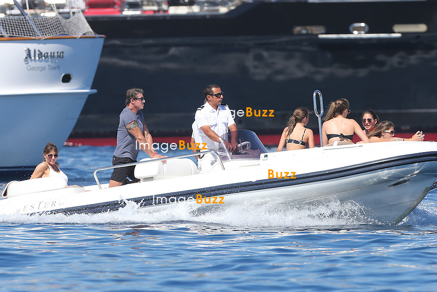 Sylvester Stallone, his three daughters Sophia, Sistine, Scarlet and wife Jennifer Flavin are enjoying water sports during their vacation in Saint-Jean-Cap-Ferrat, in France. <br /> Stallone &amp; family are spending their vacation aboard a super yacht called &quot; Te Manu &quot; , one of the most impressive charter yachts in the world with 6 staterooms beautifully decorated in soothing neutrals that can accommodate up to 12 guests. Another exceptional feature of this yacht is the elevator that connects all of her four decks. The rental price is 199.000 Euros/week.