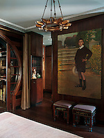 Dominating one wall of the guest bedroom is a portrait by Albert Mille, a Turkish born French artist (1872-1946). The bronze chandelier is twentieth century