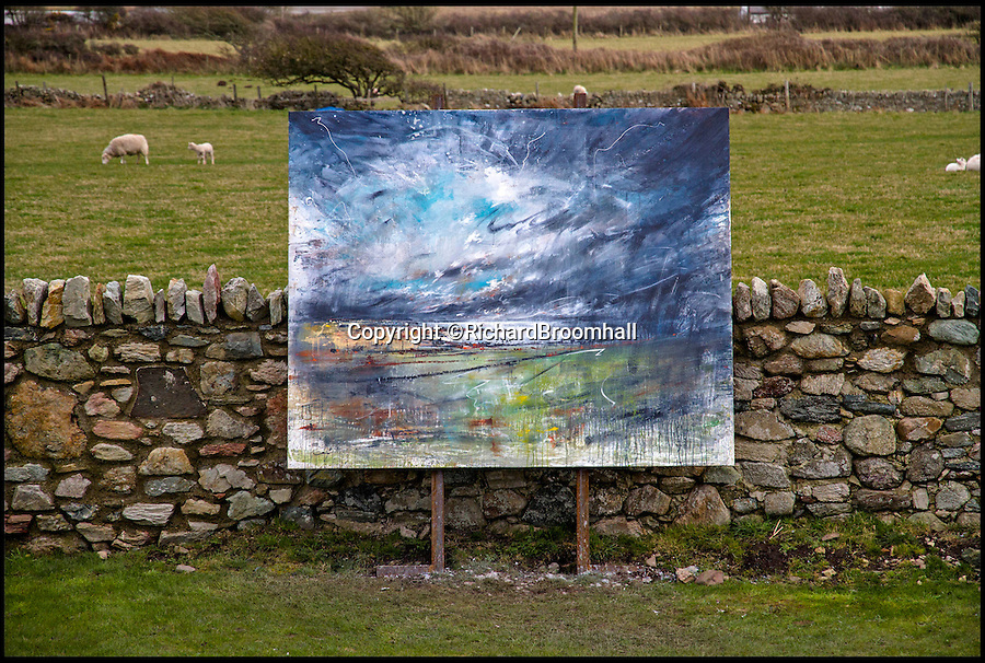 BNPS.co.uk (01202 558833)<br /> Pic: RichardBroomhall/BNPS<br /> <br /> Artist in Residence...Rhoscolyn Bay.<br /> <br /> Artist Anthony Garratt is giving a whole new meaning to landscape painting - his incredible pieces aren't just of the landscape, they're in it too.<br /> <br /> The 35-year-old painter from Bristol has created four canvasses on the island of Anglesey as part of a new outdoor art installation and the paintings will remain in the exact spot they were painted until October.<br /> <br /> Mr Garratt spent several days on each of the giant 8ft-wide scenes, which are exposed to the elements and can be enjoyed by walkers as well as art fans. <br /> <br /> The landscapes had to be created on marine board - a thick marine plywood treated with sealant and epoxy, like a boat - rather than normal canvas, coated with five layers of varnish afterwards and mounted on bespoke steel frames to ensure they survive any harsh outdoor conditions.