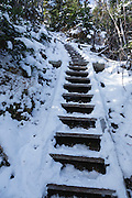 Snow-covered trail ladder along the Osseo Trail in Lincoln, New Hampshire USA during the autumn months.