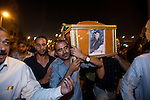 Egyptian Coptic Christians march with the coffins of victims of sectarian violence October 10, 20011 from the Coptic Hospital in Cairo, Egypt to the Coptic Cathedral a short distance away. At least 26 people, mostly Christian, were killed during sectarian clashes that saw the worst violence since the Revolution that toppled former Egyptian president Hosni Mubarak earlier this year. Egyptian Coptic Christians make up about 10% of Egypt's 80 million population and periodically violence flares between the Christian minority and the majority Muslim population. (Photo by Scott Nelson)
