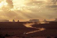 Utah, Arizona, Navajo Nation, Monument Valley, dirt road &amp; Pickup Truck