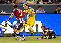 Columbus Crew midfielder Robbie Rogers (18 ) move's past Chivas USA fmidfielder Ante Jazic (6). CD Chivas USA defeated the Columbus Crew 3-1 at Home Depot Center stadium in Carson, California on Saturday July 31, 2010.