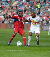 Chicago forward Sherjill MacDonald (7) ties to hold off New York defender Jamison Olave (4).  The Chicago Fire defeated the New York Red Bulls 3-1 at Toyota Park in Bridgeview, IL on April 7, 2013.