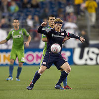 New England Revolution midfielder Pat Phelan (28) controls the ball while under pressure. In a Major League Soccer (MLS) match, the Seattle Sounders FC defeated the New England Revolution, 2-1, at Gillette Stadium on October 1, 2011.