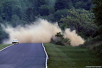 Harry Theodoracopulos crashes his DeKon Monza during practice for the 1975 IMSA race at Lime Rock Park near Lakeville, Connecticut.
