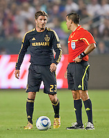 CARSON, CA – July 4, 2011: LA Galaxy midfielder David Beckham (23) and referee Ricardo Salazar during the match between LA Galaxy and Seattle Sounders FC at the Home Depot Center in Carson, California. Final score LA Galaxy 0, Seattle Sounders FC 0.