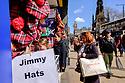 "Edinburgh, UK. 15.04.2017. People look at a shop selling ""Jimmy Hats"" on Princes Street. Photograph © Jane Hobson."