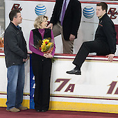 Kevin Pratt (BC - Student Manager) had to climb over the bench to rejoin his parents Tom and Linda Pratt. - The visiting University of Notre Dame Fighting Irish defeated the Boston College Eagles 2-1 in overtime on Saturday, March 1, 2014, at Kelley Rink in Conte Forum in Chestnut Hill, Massachusetts.