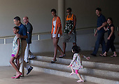 United States President Barack Obama walks with family and friends after viewing a gallery featuring an exhibit on the anthropological work of the president's late mother, Stanley Ann Dunham. It's called &quot;Through Her Eyes: Ann Dunham's Field Work in Indonesia.&quot; at the East-West Center in Honolulu, Hawaii, Sunday, January 1, 2012. President Obama is in Hawaii with his family for a low-key vacation. Sasha Obama is walking with the President and Malia Obama and first lady Michelle Obama follow behind..Credit: Kent Nishimura / Pool via CNP