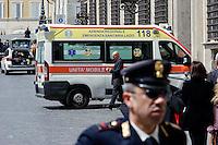 Roma 28 Aprile 2013.L'arrivo di un ambulanza  sul luogo della sparatoria davanti Palazzo Chigi dove sono stati feriti due carabineri da un uomo poi arrestato.