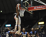 "Ole Miss' Reginald Buckner (23) dunks vs. East Tennessee State at the C.M. ""Tad"" Smith Coliseum in Oxford, Miss. on Saturday, December 14, 2012. Mississippi won 77-55 to improve to 7-1. (AP Photo/Oxford Eagle, Bruce Newman).."