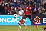 15 October 2014: Christen Press (USA) (14) shoots past Kennya Cordner (TRI) (19). The United States Women's National Team played the Trinidad and Tobago Women's National Team at Sporting Park in Kansas City, Kansas in a 2014 CONCACAF Women's Championship Group A game, which serves as a qualifying tournament for the 2015 FIFA Women's World Cup in Canada. The United States won the game 1-0.
