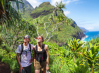 Hikers take in the lush surroundings along the Kalalau Trail near Hanakapi'ai Beach, Kaua'i.