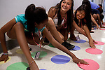 From left: Alyssa Huang, 15, Kiara Figueroa, 13, and Jessica Chou, 15, play twister during Afternoon Activities at the Center for Talented Youth summer program at Lafayette College in Easton, PA on July 06, 2012. Several students were part of the Rural Connections scholarship program being offered for the first time this year.