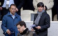 FUSSBALL  CHAMPIONS LEAGUE  HALBFINALE  RUECKSPIEL  2012/2013      Real Madrid - Borussia Dortmund                   30.04.2013 Hansi Flick  und Bundestrainer  Joachim Loew (v.l.) zu Gast auf der Tribuene