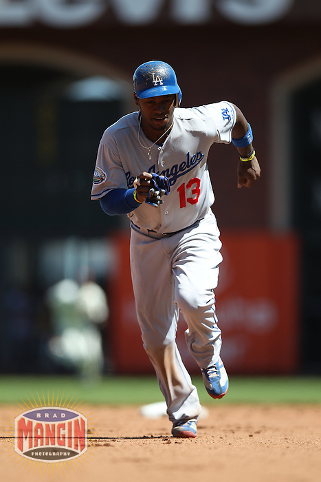 SAN FRANCISCO, CA - JULY 28:  Hanley Ramirez #13 of the Los Angeles Dodgers runs the bases against the San Francisco Giants during the game at AT&T Park on Saturday, July 28, 2012 in San Francisco, California. Photo by Brad Mangin