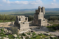 Low angle view of the Arch of Septimius Severus, 205 A.D., with the landscape in the background, in Dougga, Tunisia, pictured on January 31, 2008, in the afternoon. Dougga has been occupied since the 2nd Millennium BC, well before the Phoenicians arrived in Tunisia. It was ruled by Carthage from the 4th century BC, then by Numidians, who called it Thugga and finally taken over by the Romans in the 2nd century. Situated in the north of Tunisia, the site became a UNESCO World Heritage Site in 1997. The arch of the Roman emperor was constructed in 205 A.D. to commemorate the town's new status of Municipium. This status granted self-governance and full rights of Roman citizenship for its people. Picture by Manuel Cohen.