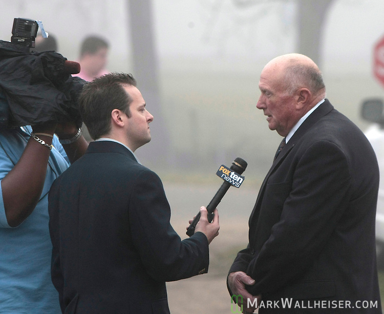 Reporters interview Geneva mayor Wynnton Melton (R) just after dawn  March 11, 2009 in front of the house where five of the 11 people where shot to death in Samson, Alabama.  Geneva County Sheriff Greg Ward said the 11 people, included the suspected gunman, were killed in the shooting spree and car chase in southern Alabama on March 10, 2009.      (Mark Wallheiser/TallahasseeStock.com)