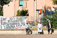 Roma 4 Ottobre 2014<br /> La comunit&agrave; islamica prega il primo giorno di Eid al-Adha, o Festa del Sacrificio, che segna la fine del pellegrinaggio Hajj alla Mecca, che ricorda la disponibilita del  Profeta Abramo di sacrificare suo figlio a Dio, al quartiere multietnico di Torpignattara. Striscione di solidariet&agrave; per il ragazzo italiano arrestato che ha ucciso un immigrato pakistano.<br /> Rome 4 October 2014 .<br /> Muslims praying on the first day of Eid al-Adha, or the Festival of Sacrifice, which marks the end of the Hajj pilgrimage to Mecca and commemorates Prophet Abraham's readiness to sacrifice his son to show obedience to God, to the multi-ethnic neighborhood Torpignattara.<br /> in the pictured: Banner of solidarity to the Italian boy arrested that killed a Pakistani immigrant to punch