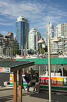 Tourist boarding the aquabus harbour tour boat, Granville Island, Vancouver, British Columbia, Canada