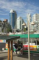 Tourist boarding the aquabus harbour tour boat, Granville Island, Vancouver, British Columbia, Canada