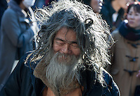 An unkempt homeless man in Shibuya, Tokyo. Japan. Sunday December 9th 2012