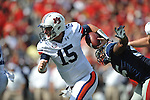 Auburn quarterback Clint Moseley (15) runs from Ole Miss defensive end Cameron Whigham (55) at Vaught-Hemingway Stadium in Oxford, Miss. on Saturday, October 13, 2012.