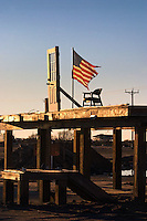 An American flag flies at the remains of a home on Bolivar Island 3 months after Hurricane Ike swept over the peninsula in 2008.