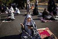 Women pray during Eid al-Fitr.