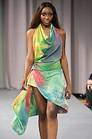 Model walks runway in an outfit from the Jet Art Designs collection, by Princess Tarinan Von Anhalt, during Couture Fashion Week New York Fall 2012.