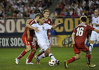 US forward Clint Dempsey (8) is pressured by Poland defender Dariusz Pietrasiak (24).  The U.S. Men's National Team tied Poland 2-2 at Soldier Field in Chicago, IL on October 9, 2010.