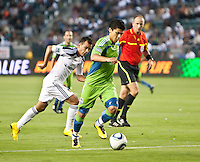 Seattle Sounders forward Fredy Montero (17) pushes the ball up field as LA Galaxy midfielder Juninho (19) races to catch him during the first half of the game between LA Galaxy and the Seattle Sounders at the Home Depot Center in Carson, CA, on July 4, 2010. LA Galaxy 3, Seattle Sounders 1.