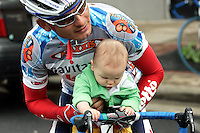 Fred Rodriguez of Davitamon-Lotto plays with his eight-month-old son, Aidan, before the start of Stage 4 of the Ford Tour de Georgia.  Rodriguez won the 118.9-mile (191.4-km) stage from Dalton to Dahlonega.<br />