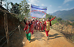 Women march together in celebration of International Women's Day on March 8, 2016, in Dhawa, a village in the Gorkha District of Nepal.<br /> <br /> The banner reads, &quot;106th International Women's Day&quot; and &quot;Implement the Constitution and Guarantee Women's Rights.&quot;